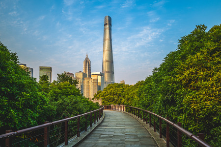skyline of shanghai city and a wooden pathway