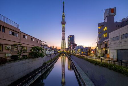 street view of tokyo with landmark tower at night