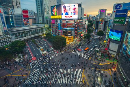 Tokyo, Japan - June 12, 2019: Shibuya Crossing, a world famous and iconic intersection in Shibuya, Tokyo. Hundreds of people from all directions at once cross at a time.