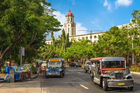 street view of manila with jeepney and clock tower Stock Photo