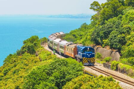 scenery of southern taiwan with railway and train