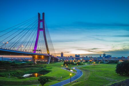 """New Taipei Metropolitan Park (Erchong Floodway Riverside Park). the translation of the chinese text is """"new taipei city bridge"""""""