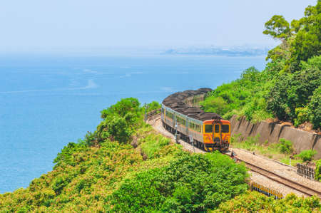 Train runs on South link line of taiwan railway in pingtung county 版權商用圖片