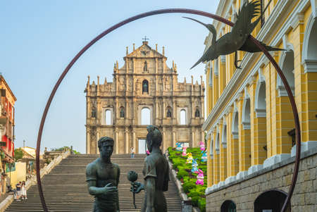 The Friendship Statue, man woman and a dog, located at the steps leading to the ruins of saint paul in macau, china. It was a symbol of East meets West figure and friendship