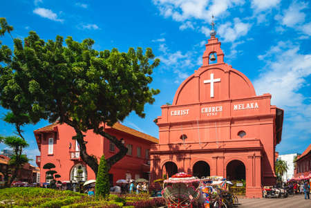 August 12, 2018: Stadthuys and Melaka Red Clock Tower, aka Tang Beng Swee Clock Tower, located at Dutch Square in, Melaka, Malacca, Malaysia. Stadthuys was built in 1650 and clock tower was in 1886.