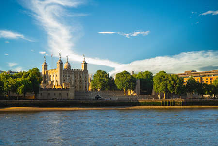 tower of london by river thames in london, england, UK