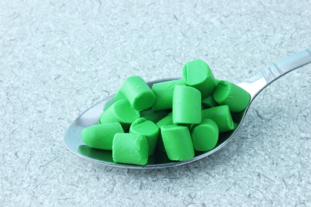 A Spoonful of green plasticine pieces