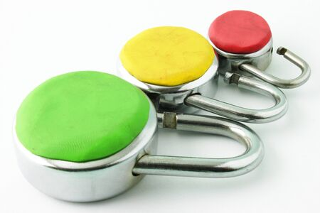 Different levels of security depicted with three padlocks in different colors and sizes Stock Photo - 16479002