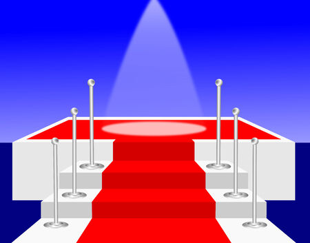 Stairs with a red carpet leading to a stage with a spot light on the centre of the stage