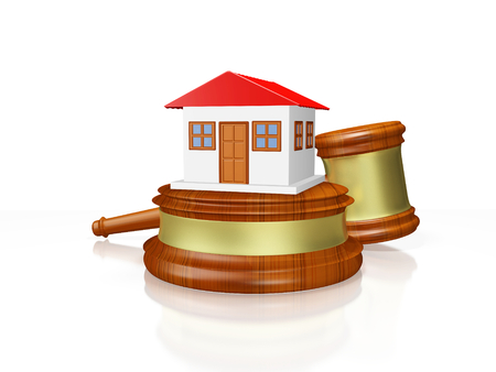A 3D illustration of a tiny house model with red roof, placed on a judges wooden block and gavel or mallet behind it. Ideal for use in house auction, property law and property disputes related concepts. Stock Photo