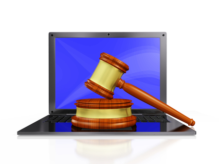 A 3D illustration of cyber law depicted with a wooden judges gavel or mallet and block, placed on a laptop computer. Ideal for use in online auction, cyber law and cyber crime related concepts. Stock Photo