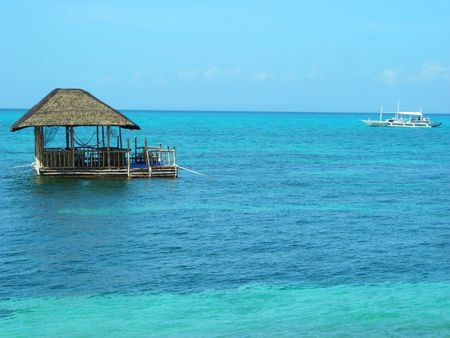 Floating hut at tropical island Standard-Bild