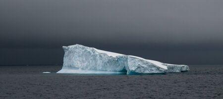 Antarctic iceberg in stormy weather