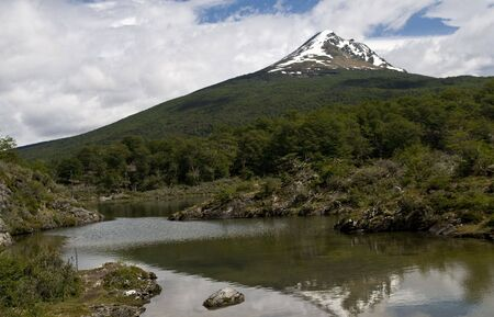 tierra: A well forested mountain with a snow covered peak - Tierra Del Fuego