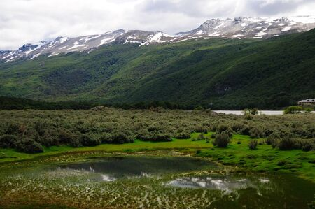tierra: A panoramic scene from Tierra Del Fuego National Park in ArgentinaChile, with mountains, meadows and forests.