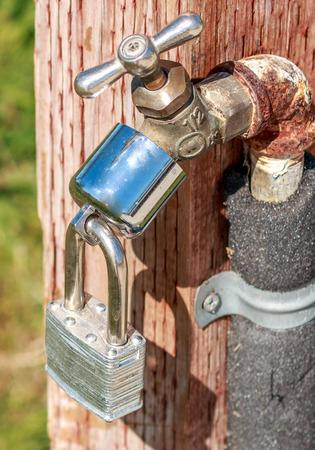 locked in: Locked water spigot in a California Park Stock Photo