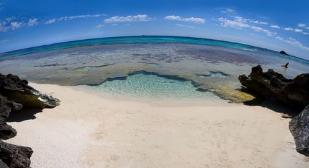 turqoise: View of a deserted beach with turqoise waters, taken with a fisheye lens (hence strong curvature of the horizon). Captured at Rottnest Island, Australia