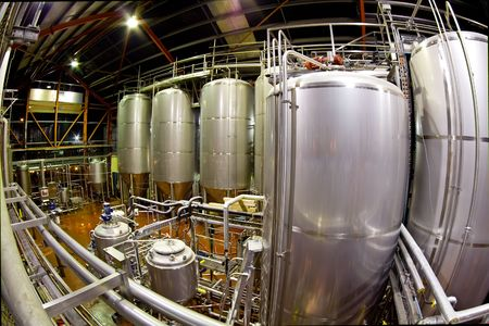 vats: View of the machinery and vats inside a brewery. Image captured with a fisheye lens