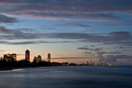 View of the high rise buildings of Surfers Paradise in the distance (Gold Coast, Queensland, Australia). Image taken at sunsetdusk.  photo
