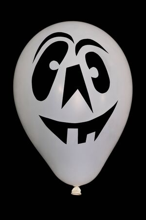 ghost face: The photo of an white balloon on Halloween whith ghost face Stock Photo