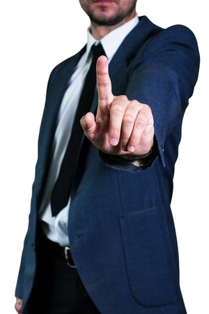 Young businessman man in jacket and white shirt shows gesture with your index finger. Business concept, focus on hand