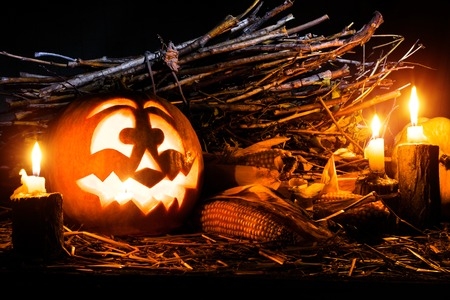 Photo for the holiday Halloween. Evil pumpkin lamp background. All Saints Eve