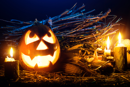 Photo for the holiday Halloween. Evil pumpkin lamp background