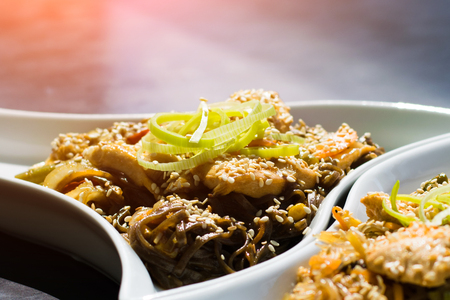 Asian food. A close-up of Chinese udon noodles with curry chicken.