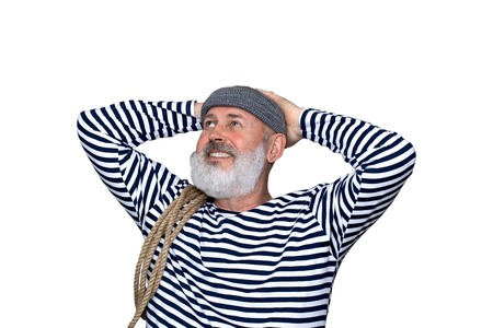 Photo portrait of a cheerful sailor holding a rope. A man with a gray beard, wearing a black and white striped shirt and a gray cap with a lapel