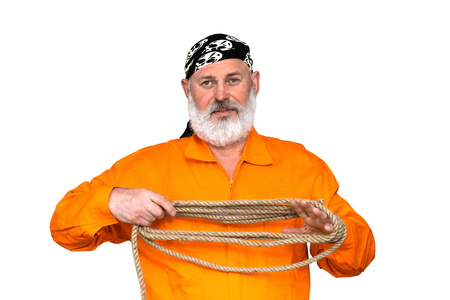 Portrait of a sailor in a marine working uniform in orange colors. A middle aged man with a gray beard. Seaman winding rope