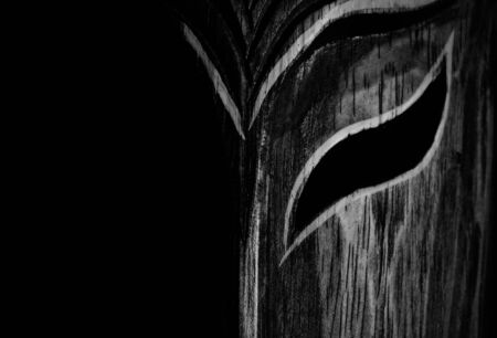 sidelight: Wooden human face in sidelight, light and shadow head Stock Photo