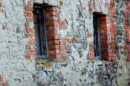 Two windows in the old stone brick wall. photo
