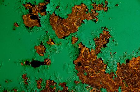 Rusty surface of green paint iron surface photo