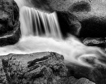 Detail of small waterfall on mossy rock. photo