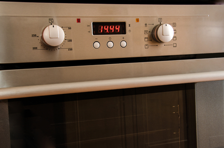 Steel cuisine oven with lot of buttons and the display photo