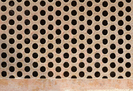reticular: Texture of old rusty dirty grate with circle holes.