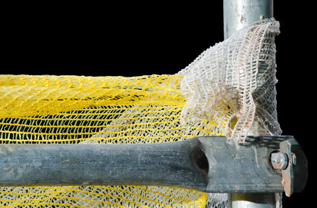 Detail of two steel scaffold pipes isolated on yellow sow background. photo