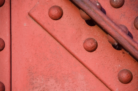 Oxided red iron bridge construction, texture detail. photo