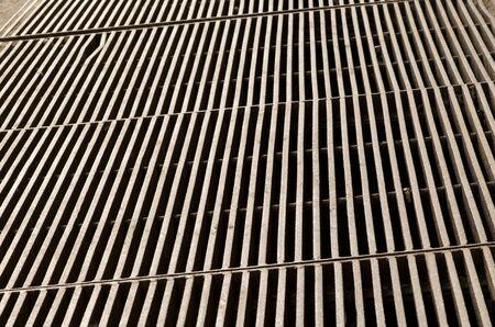 Metal grate bars floor as dangerous construction. photo