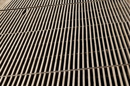dangerous construction: Metal grate bars floor as dangerous construction. Stock Photo