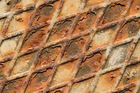 Rusty surface of iron floor, diagonal pattern. photo