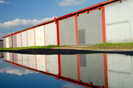 A lot of garages, puddle with reflection. photo