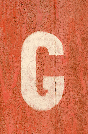Letter painted on old rusty iron wall of garage. photo