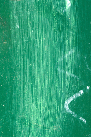 Green surface of metal plate with white lines. photo