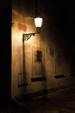 Street at night, nice street light and red sign. photo