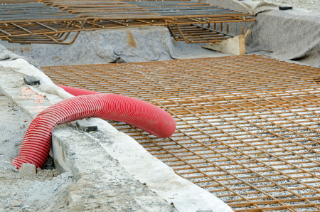 Street repairing, metal bolter and red pipe. photo