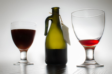 Bottle of wine and two glasses isolated on backround. photo