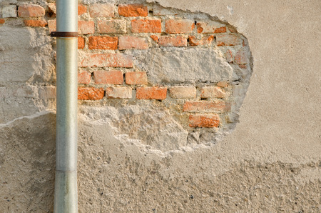 fasade: Metal evaes and brick wall with old chapped fasade. Stock Photo