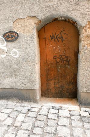 Small orange wooden doors. Peaceful german lane. photo