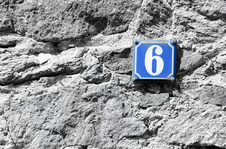 factorial: House number six on the blue board.